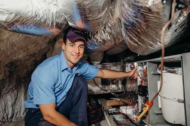 hvac technician working on a furnace