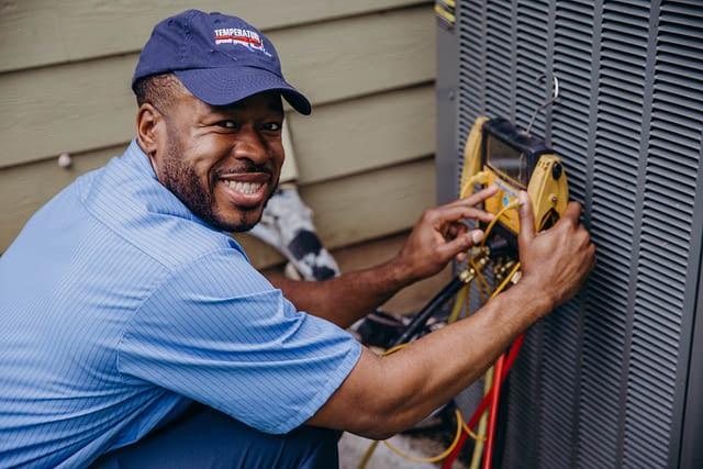 technician inspecting HVAC unit